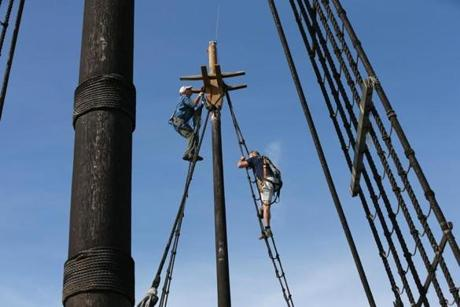 Peter Arenstam of Plimoth Plantation and volunteer Thomas Bott had duties high in the rigging on Wednesday.